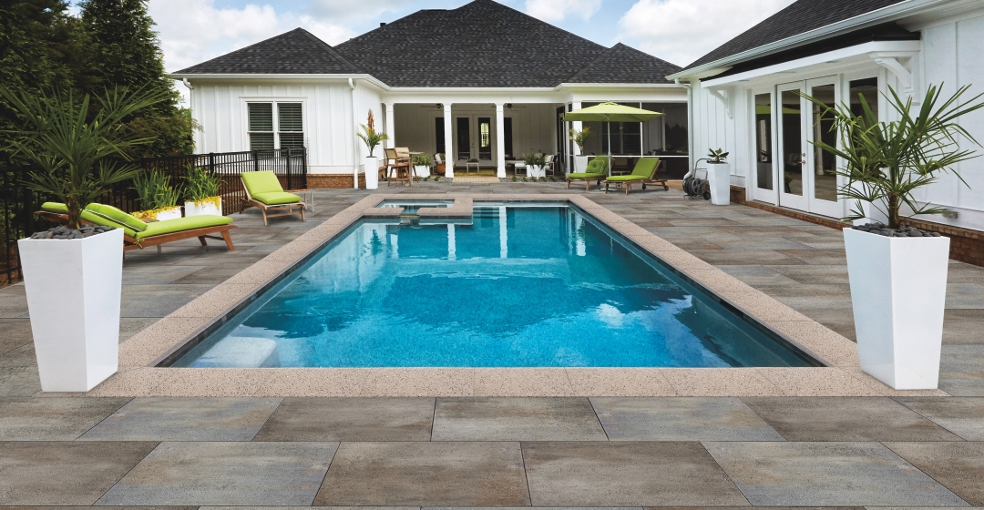 Patio and pool using Nueva® XL Slab and Oasis Bullnose products from Brampton Brick