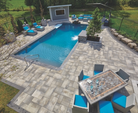 Patio with pillars and planter wall using Nueva® Slab, Monterey and Modan products from Brampton Brick