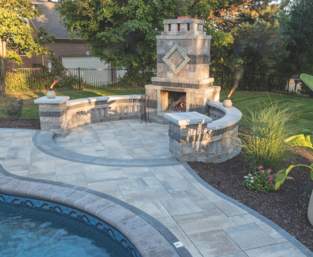 Patio with pool and fireplace using Rialto, Cassina Coping and Classic Series products from Brampton Brick